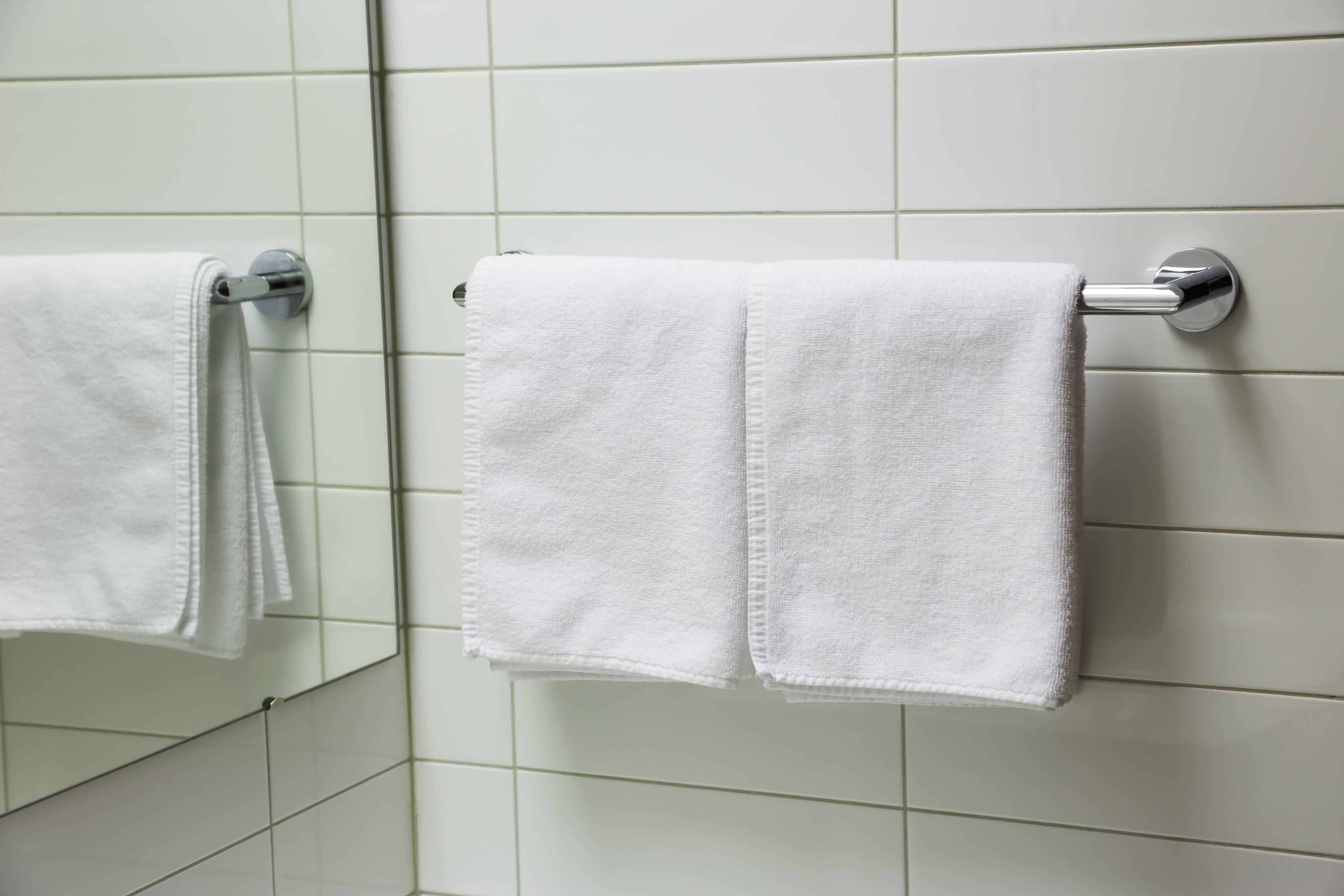two folded towels on towel rail