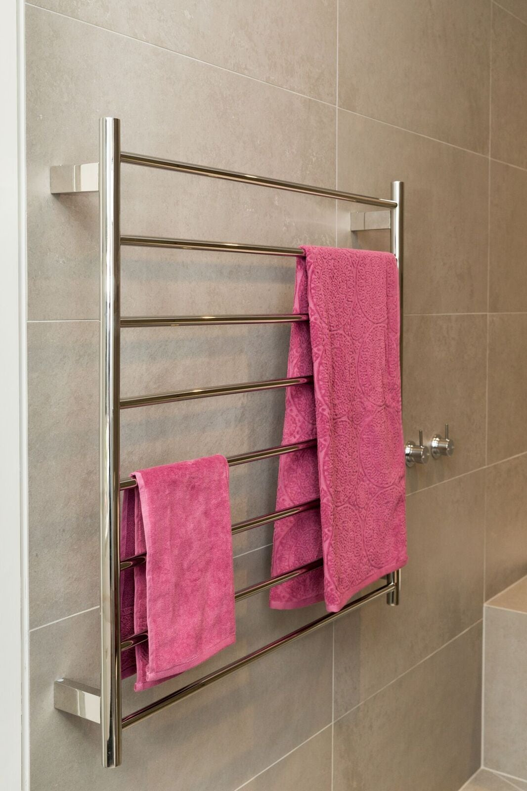 towel warmer with two pink towels