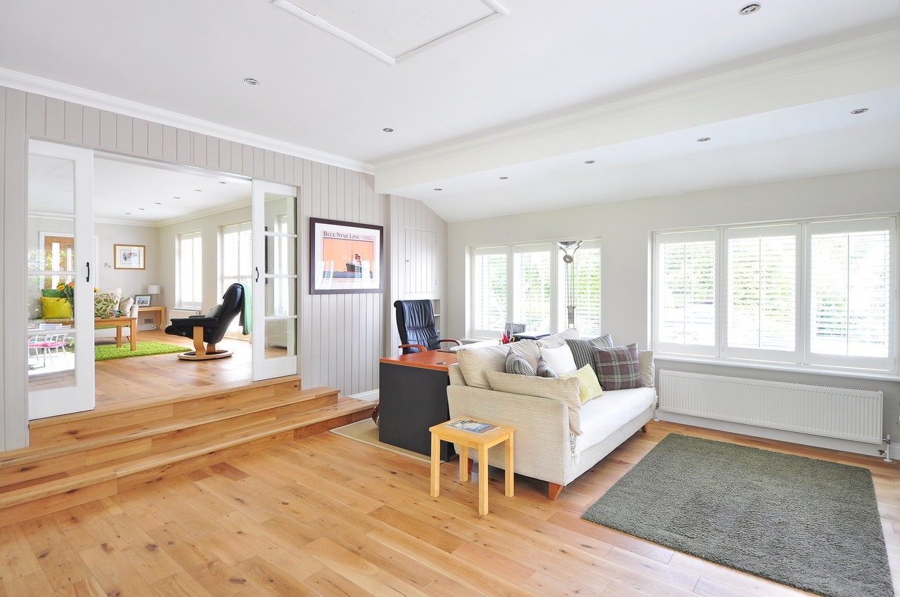 family room white ceiling walls wood floorboards grey carpet