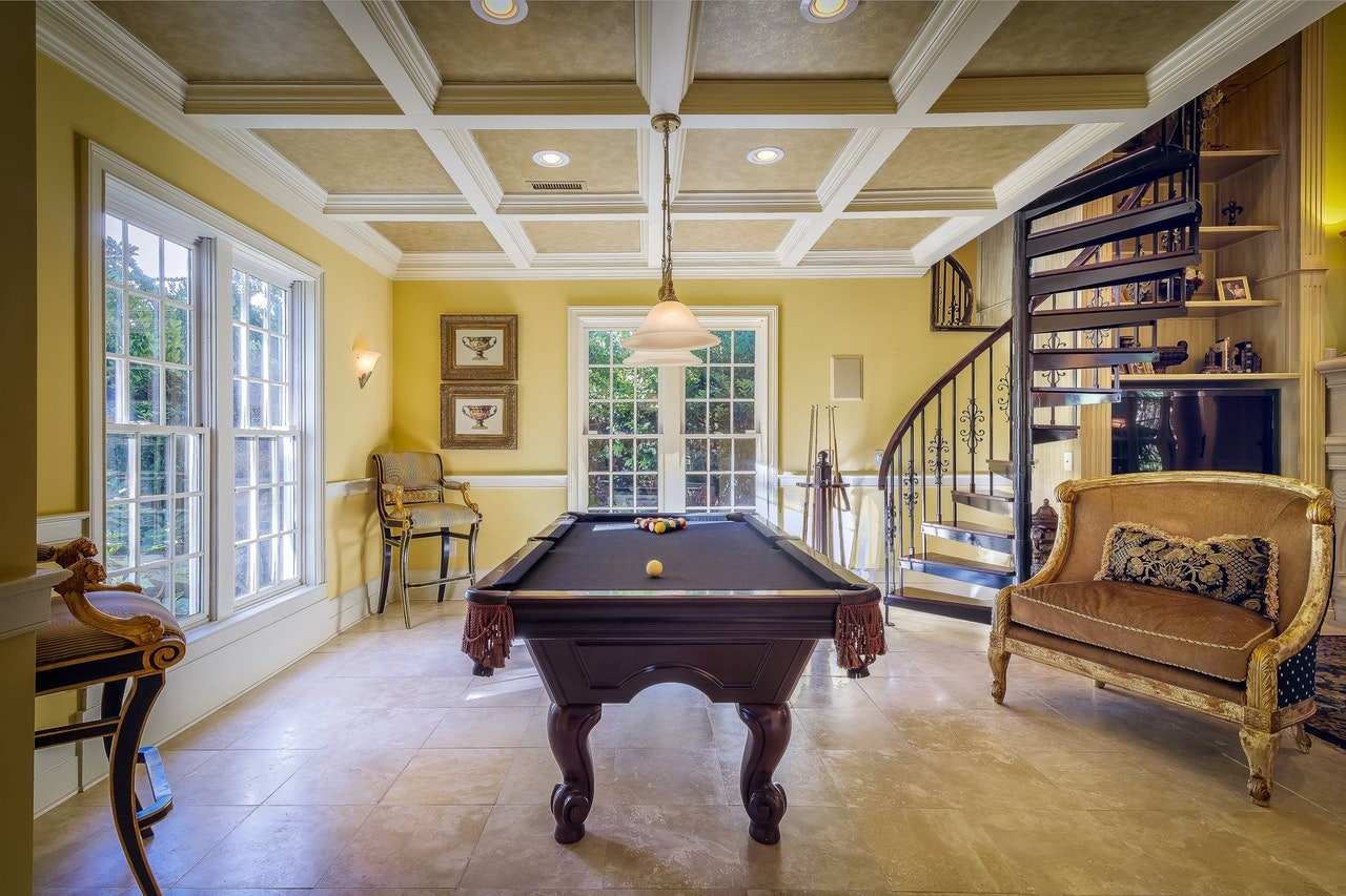 period family room with pool table yellow walls tiled floors winding stairs