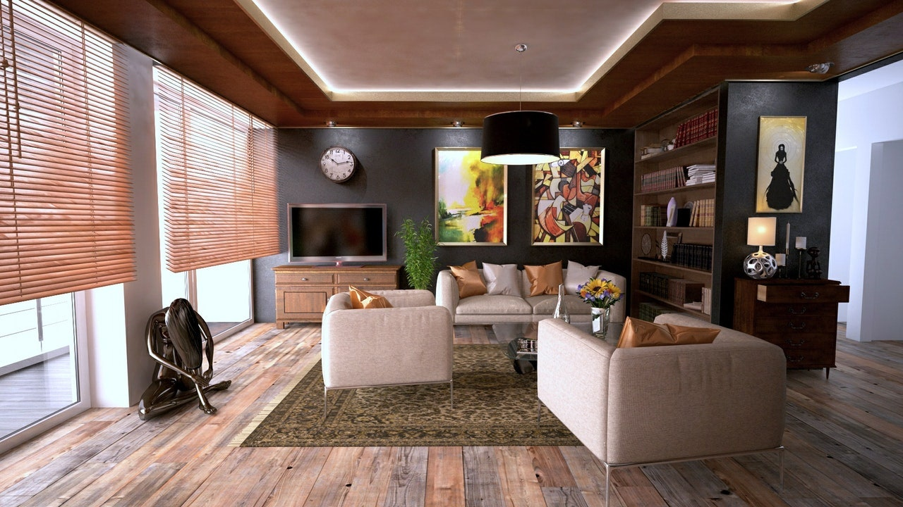 family room with bookshelves tv sofa sculpture lamp blinds carpet wooden floorboards