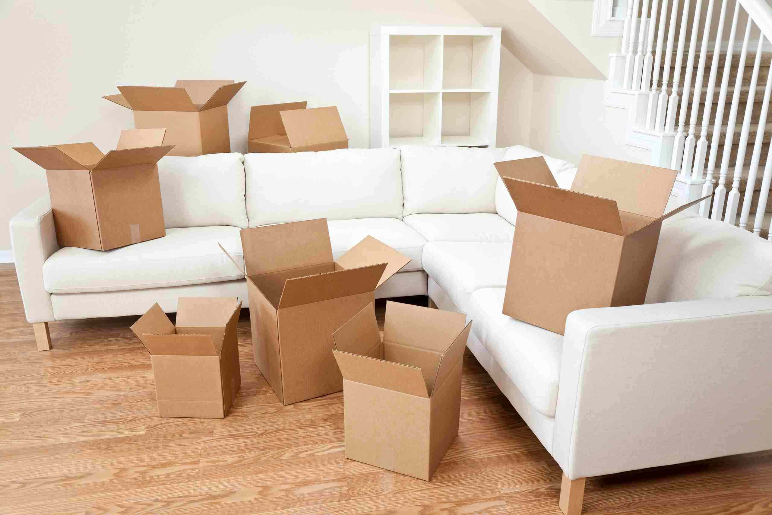 empty boxes on sofa and floor