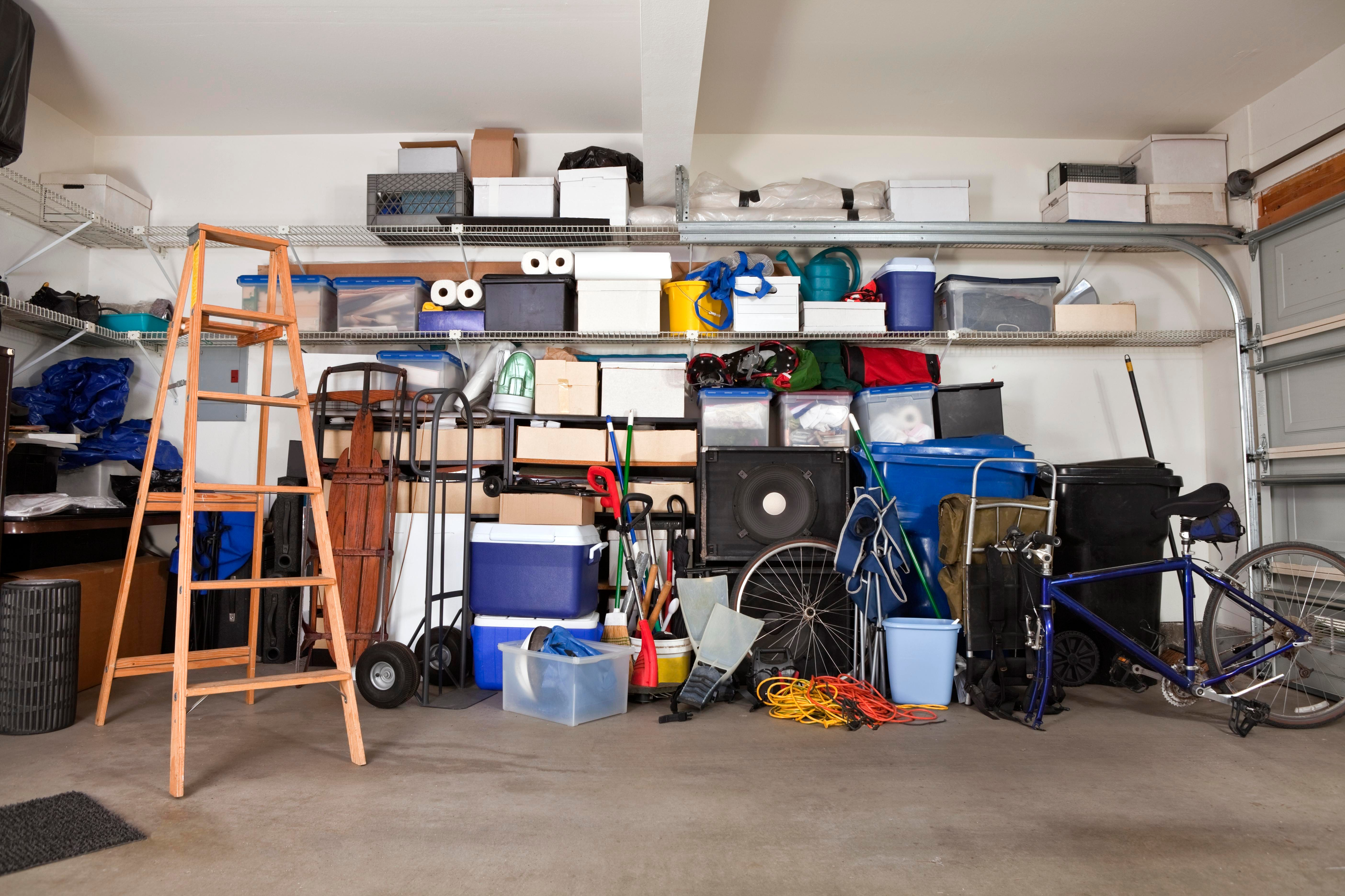 suburban garage mess with boxes, tools and toys in disarray