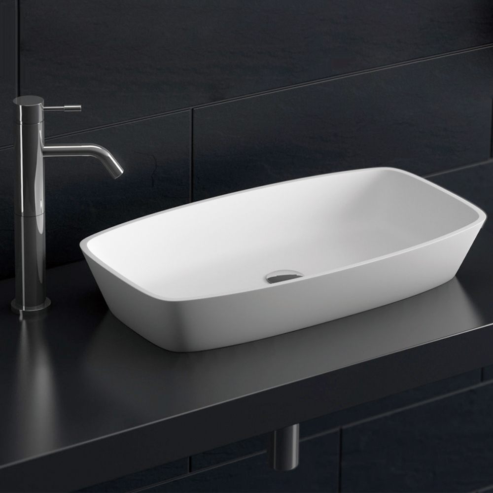 Aguzzo Brennero rounded rectangle limestone white bathroom basin on black benchtop