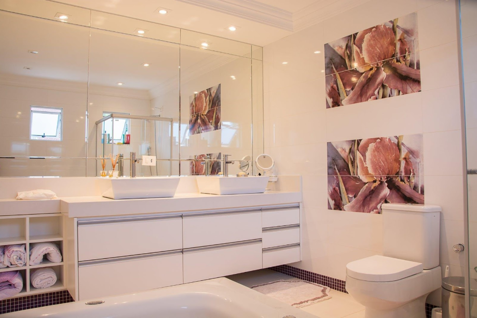 bathroom with large mirrors ceramic basins and artwork