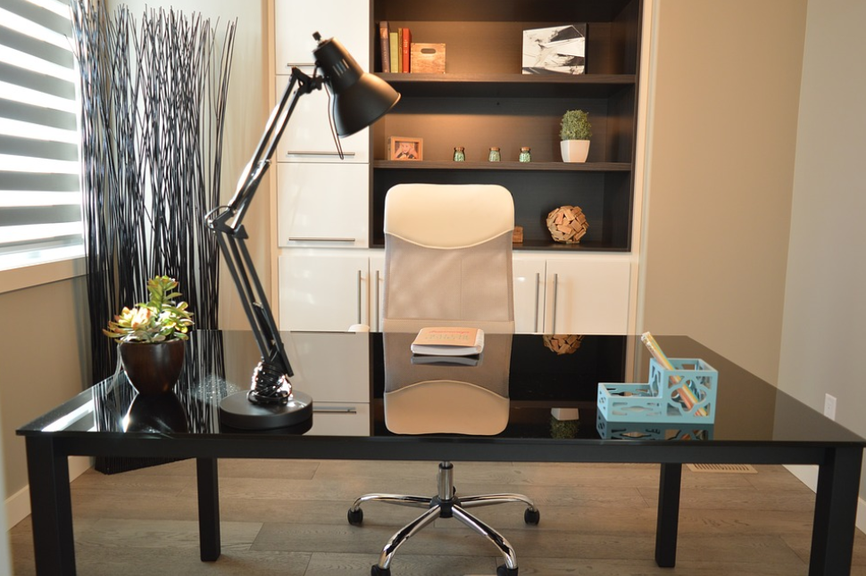home office black desk beige chair lamp wood floor